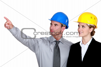 businessman and businesswoman on a construction site