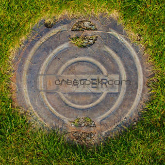 Water Manhole Cover in Grass