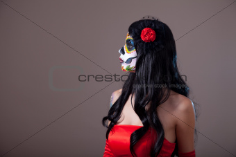 Profile view of Sugar skull girl in red dress 