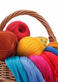 colored threads for needlework in the basket