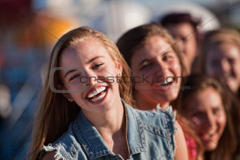 Young Blond Girl Laughing with Friends