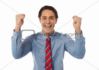 Businessman celebrating success with arms raised