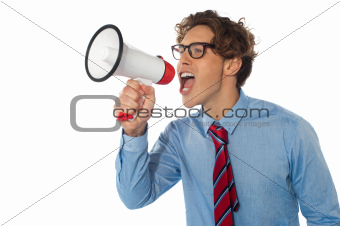 Young businessman using megaphone