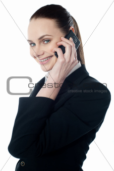 Female executive talking on mobile