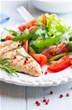 Grilled chicken fillet with salad on a plate