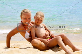 Mother and daugther on the beach