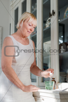 Health issues, old woman taking prescription drugs