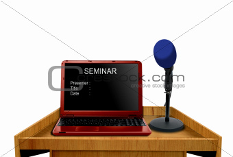 microphone and laptop on podium at seminar