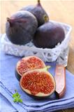 sweet fruit ripe figs on a wooden board