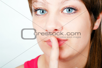 girl with a finger to his lips