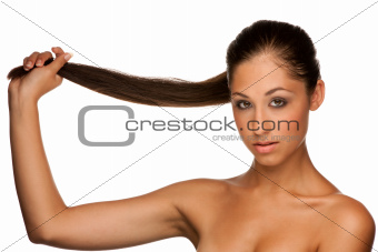 Portrait of cute caucasian brunette girl holding her hair in han