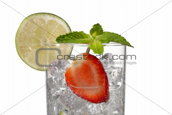 cropped image of a glass with ice cubes strawberry slice and lem