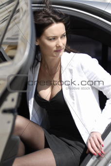 Businesswoman alighting from car