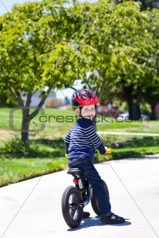 toddler on a balance bike