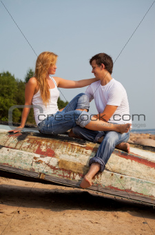 young couple on old boat