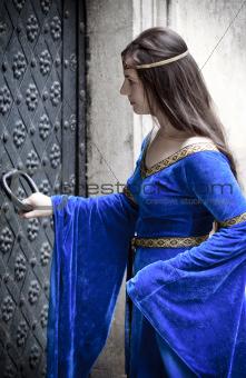 medieval girl opening door