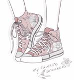 Shoes with floral pattern. Background with fashionable sneakers.