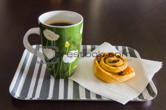 Breakfast with coffeee and raisin brioche