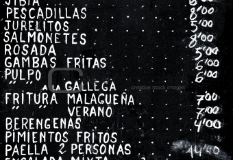 list of spanish dishes written on a blackboard