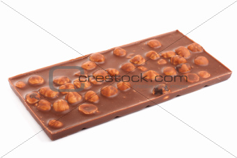 Bar of sweet chocolate with hazelnuts