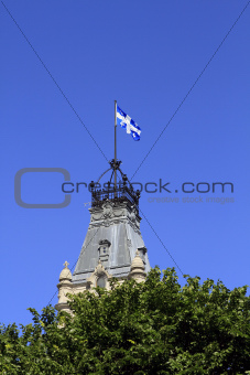 Quebec Flag over tower in trees