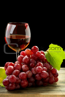 Bunch of grapes and glass of wine.
