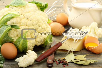 Cauliflower for baking with egg and cheese.