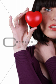 young woman holding a little red hearth