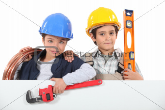 Kids dressed up as builders