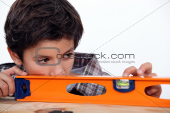 Boy with a spirit level