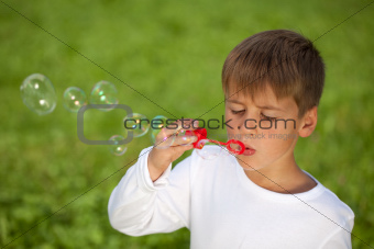 Little boy having fun with bubbles