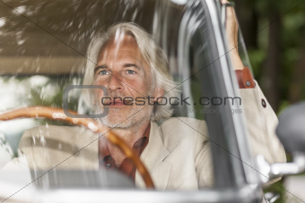 man in his car