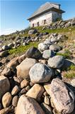 Stone house on the rocky shore.