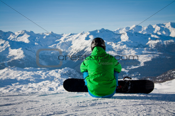 Snowboarder sitting in the snow