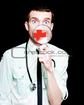 Surprised Doctor Showing Health Care Cross