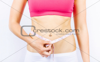 Slimming Woman Holding Tape Measure To Stomach