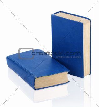 Two closed old blue books