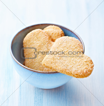 Butter cookies with sugar in a blue bowl