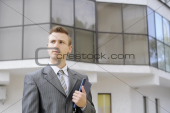 businessman holds the notebook
