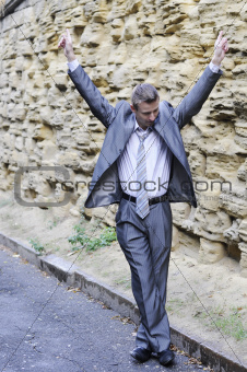 happy businessman dancing in the street