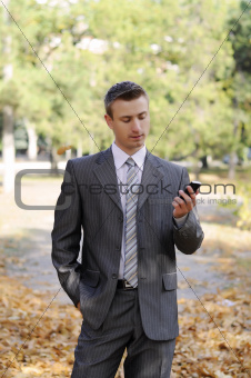 businessman looks on the phone