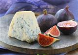blue cheese and sweet fruit  figs on a wooden board