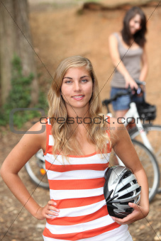 Girls cycling in the forest