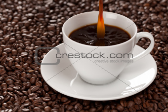 Coffee pouring into a cup