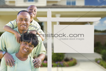 African American Family In Front of Blank Real Estate Sign and New House.