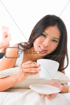 Drinking coffee on bed