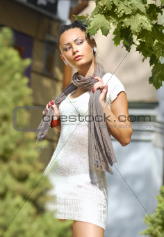 sweet young woman in autumnal city