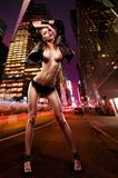 Sexy nude slim girl over night town street