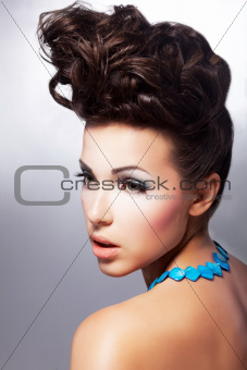 Glamorous female. Luxury coiffure and make up