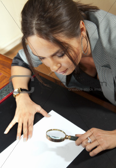 woman looks on document